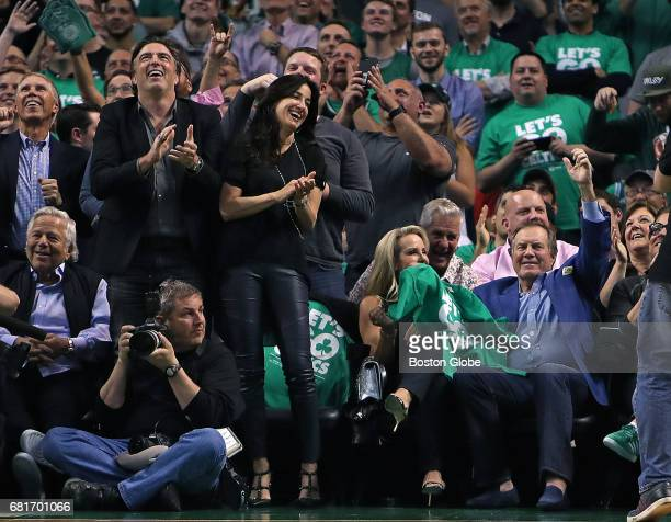 New England Patriots head coach Bill Belichick right enjoys himself as he acknowledges the applause when he is shown on the scoreboard in the fourth...