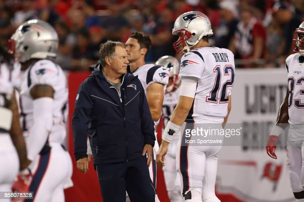 New England Patriots head coach Bill Belichick talks to New England Patriots quarterback Tom Brady before the NFL game between the New England...