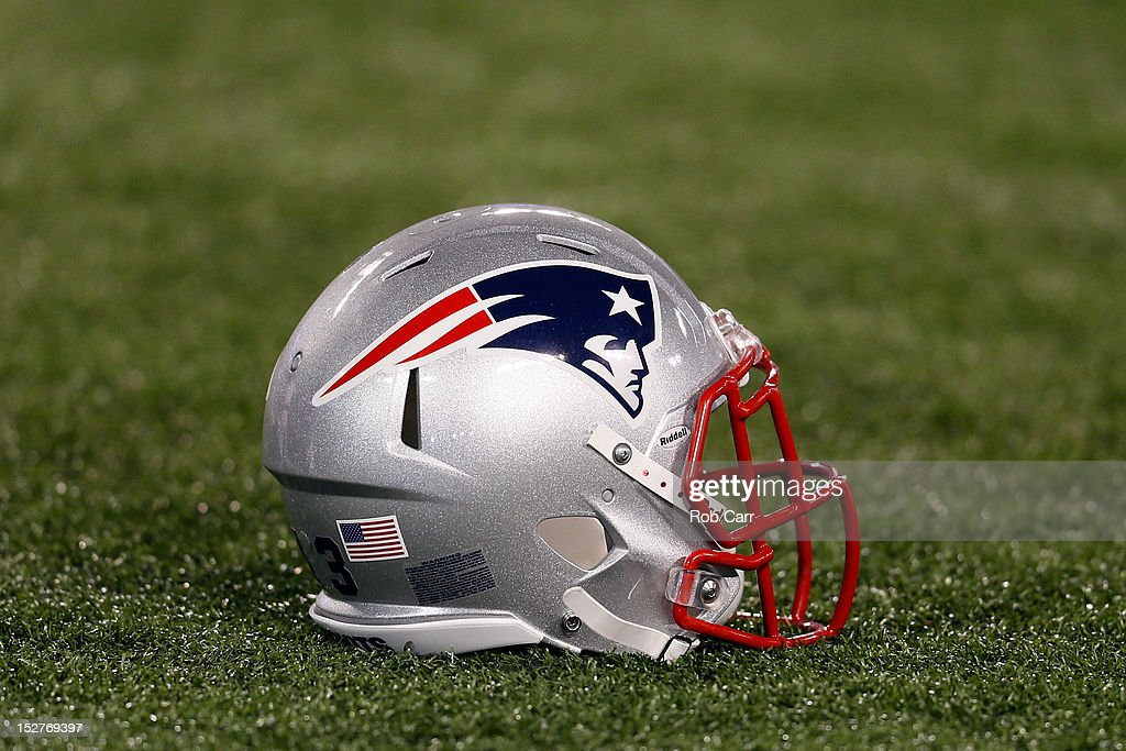 New England Patriots helmet sits on the turf before the start of the Patriots game against the Baltimore Ravens at MT Bank Stadium on September 23...