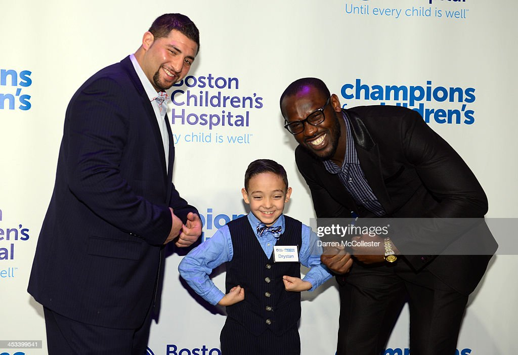 New England Patriots' <a gi-track='captionPersonalityLinkClicked' href=/galleries/search?phrase=Joe+Vellano&family=editorial&specificpeople=7256652 ng-click='$event.stopPropagation()'>Joe Vellano</a> (L) and <a gi-track='captionPersonalityLinkClicked' href=/galleries/search?phrase=Chandler+Jones&family=editorial&specificpeople=7181843 ng-click='$event.stopPropagation()'>Chandler Jones</a> attend Champions for Children's with Drystan at Seaport World Trade Center on December 3, 2013 in Boston, Massachusetts.