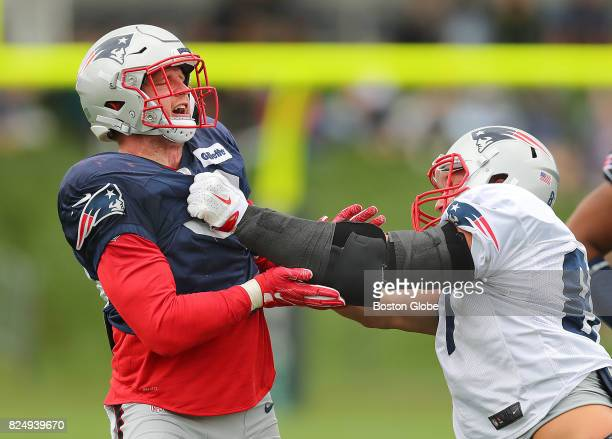 New England Patriots linebacker Shea McClellin left and Rob Gronkowski right participate in a drill during the third day of training camp at the...