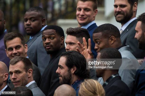 New England Patriots listens as President Donald Trump speaks during a ceremony where he honored the Super Bowl Champion New England Patriots for...