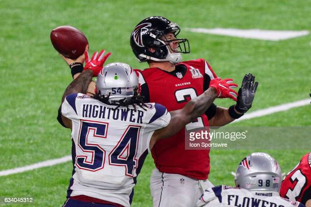 New England Patriots middle linebacker Dont'a Hightower sacks Atlanta Falcons quarterback Matt Ryan and causes a fumble during the second half of...