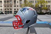 New England Patriots NFL football helmet is on display in Pioneer Court to commemorate the NFL Draft 2015 in Chicago on April 30 2015 in Chicago...