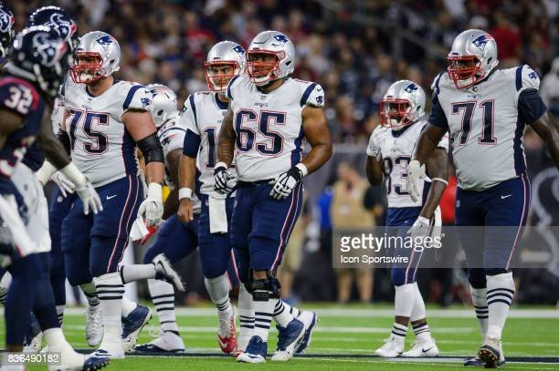 New England Patriots offensive guard Ted Karras offensive guard Jamil Douglas and offensive tackle Cameron Fleming walks up to the line of scrimmage...