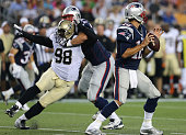 New England Patriots offensive tackle Nate Solder tries to keep New Orleans Saints defensive tackle Sedrick Ellis off New England Patriots...
