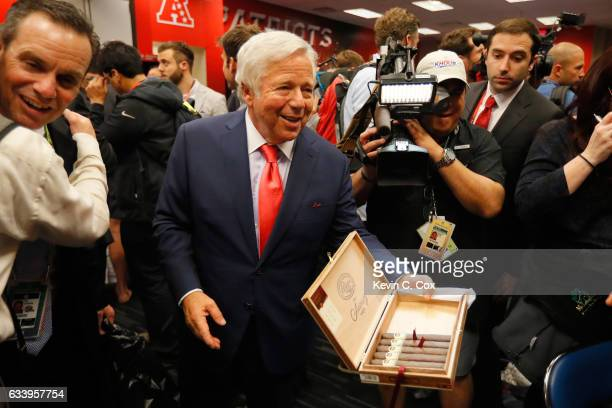 New England Patriots ownder Robert Kraft hands out cigars in the lockerroom after the Patriots defeat the Atlanta Falcons 3428 in Super Bowl 51 at...