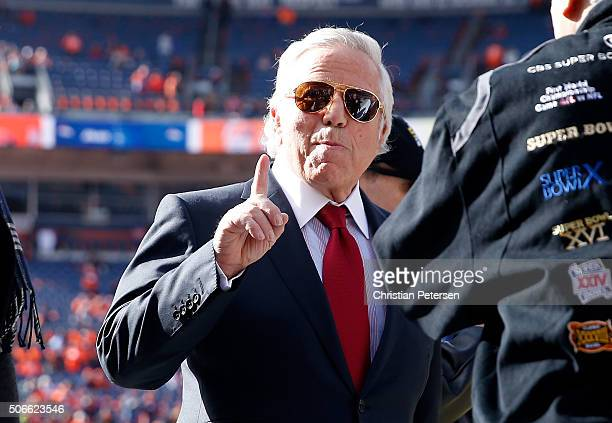 New England Patriots owner Robert Kraft gestures on the field during warm ups before the AFC Championship game against the Denver Broncos at Sports...
