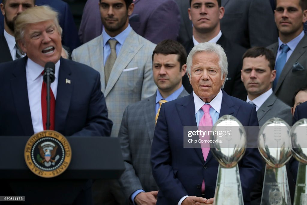 New England Patriots owner Robert Kraft (C) listens to U.S. President Donald Trump deliver remarks during an event celebrating the team's Super Bowl win on the South Lawn at the White House April 19, 2017 in Washington, DC. It was the team's fifth Super Bowl victory since 1960.