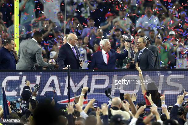 New England Patriots owner Robert Kraft raises the Lombardi Trophy after defeating the Atlanta Falcons during Super Bowl 51 at NRG Stadium on...