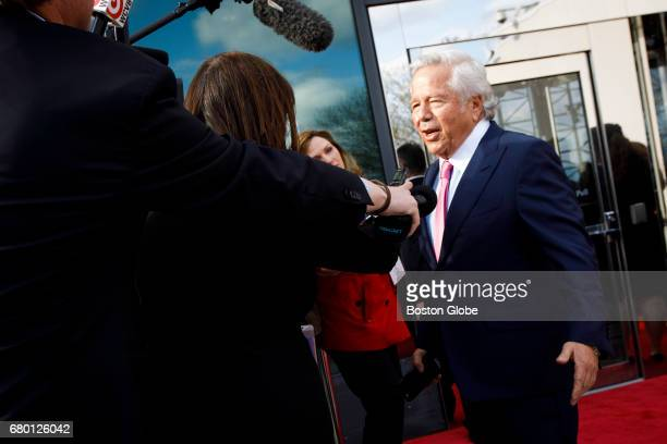 New England Patriots owner Robert Kraft talks to members of the media as he arrives for the annual John F Kennedy Profile in Courage Award at the the...