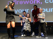 New England Patriots Patrick Chung and CeCe Chung perform with Matthew Malia and Camryn during Patrick Chung's Open Mic Holiday Party benefiting...