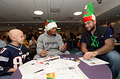 New England Patriots Patrick Chung and Mike Hoomanawanui visit with Camryn at Boston Children's Hospital December 9 2014 in Boston Massachusetts