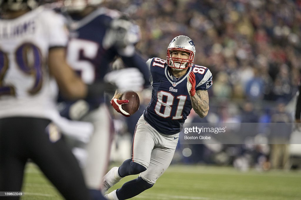 New England Patriots player Aaron Hernandez picks up yardage after a reception against the Baltimore Ravens during first quarter action of the AFC Championship Game at Gillette Stadium on Sunday, Jan. 20, 2013.