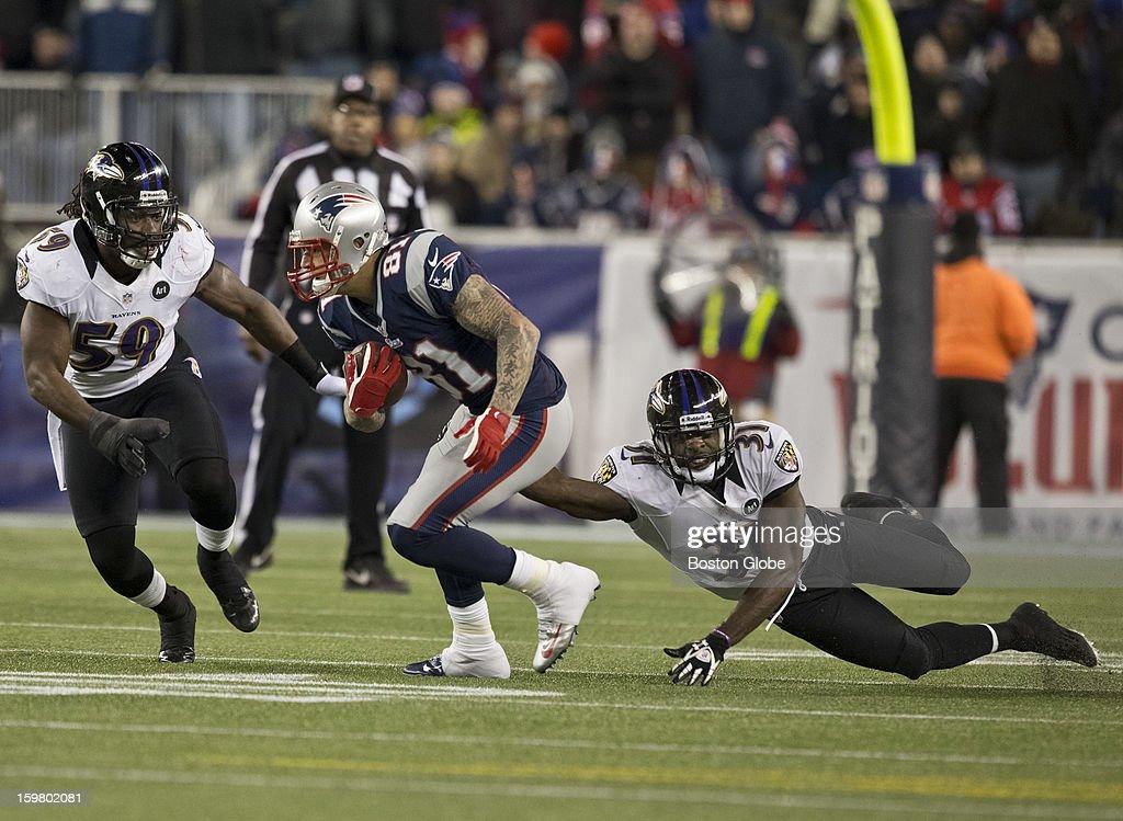 New England Patriots player Aaron Hernandez splits Baltimore Ravens defenders Dannell Ellerbee (59) and Bernard Pollard during first quarter action of the AFC Championship Game at Gillette Stadium on Sunday, Jan. 20, 2013.