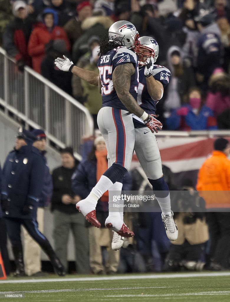 New England Patriots player Brandon Spikes, left, celebrates with teammate Rob Ninkovich after Ninkovich sacked the Baltimore Ravens' Joe Flacco on third down, forcing them to punt during second quarter action of the AFC Championship Game at Gillette Stadium on Sunday, Jan. 20, 2013.