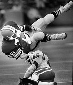 New England Patriots player Joe Peterson bottom hits Cleveland Browns player Major Everett top during a game at Sullivan Stadium in Foxborough Mass...