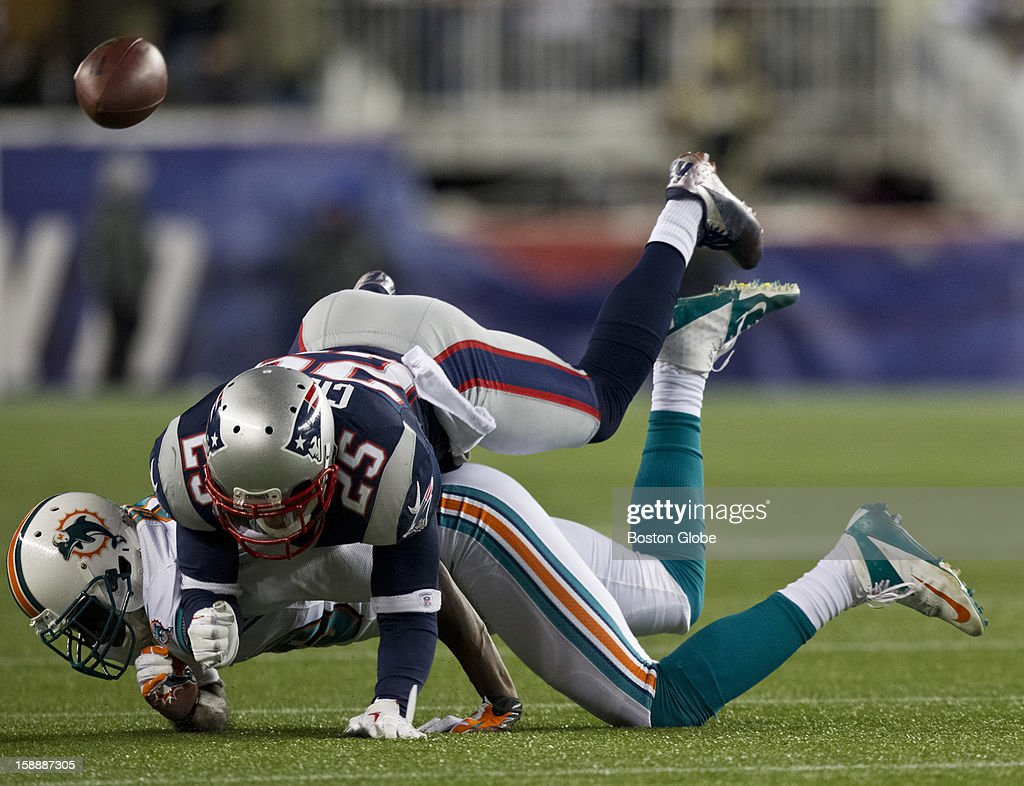 New England Patriots player Patrick Chung breaks up a pass intended for Miami Dolphins player Armpon Binns during third quarter action at Gillette Stadium on Sunday, Dec. 30, 2012.