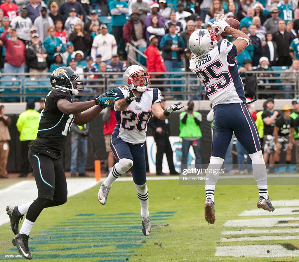 New England Patriots player Patrick Chung intercepts the ball in front of teammate Steve Gregory and Jacksonville Jaguars player Justin Blackmon during fourth quarter action at EverBank Field on Sunday, Dec. 23, 2012.