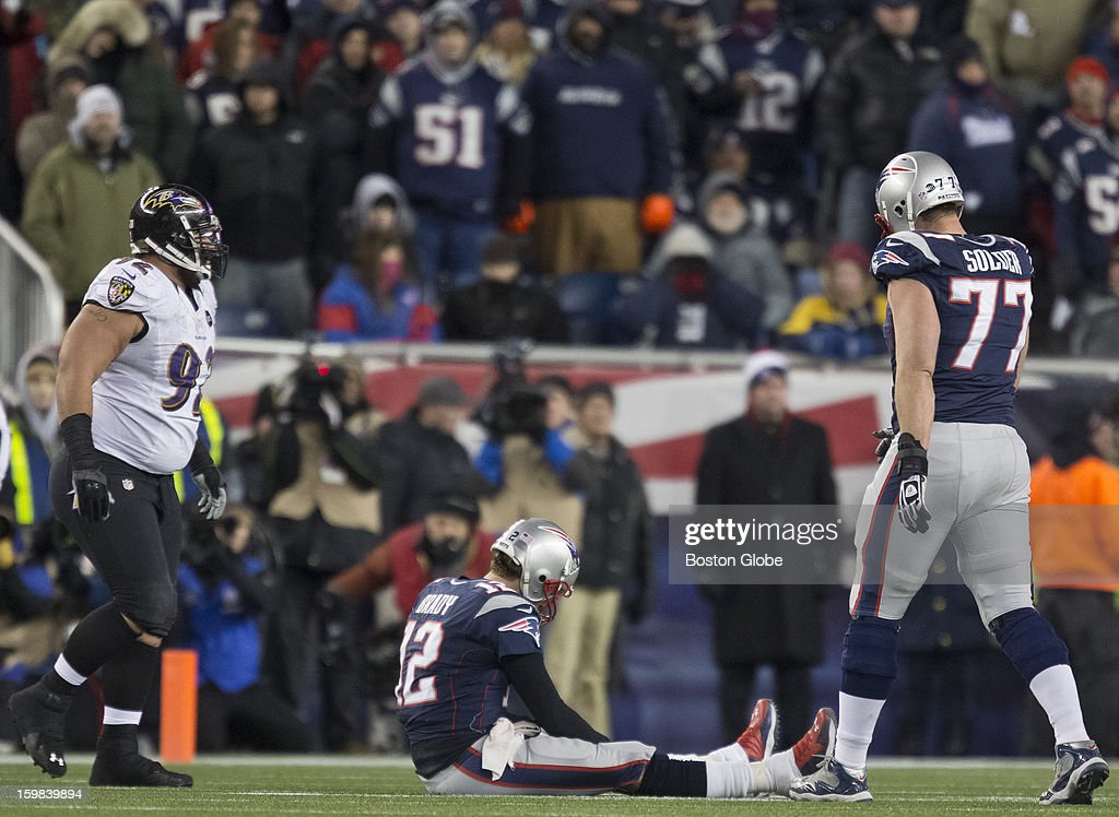 New England Patriots player Tom Brady sits on the turf after throwing an incomplete pass on fourth down against the Baltimore Ravens during the AFC Championship Game at Gillette Stadium on Sunday, Jan. 20, 2013.