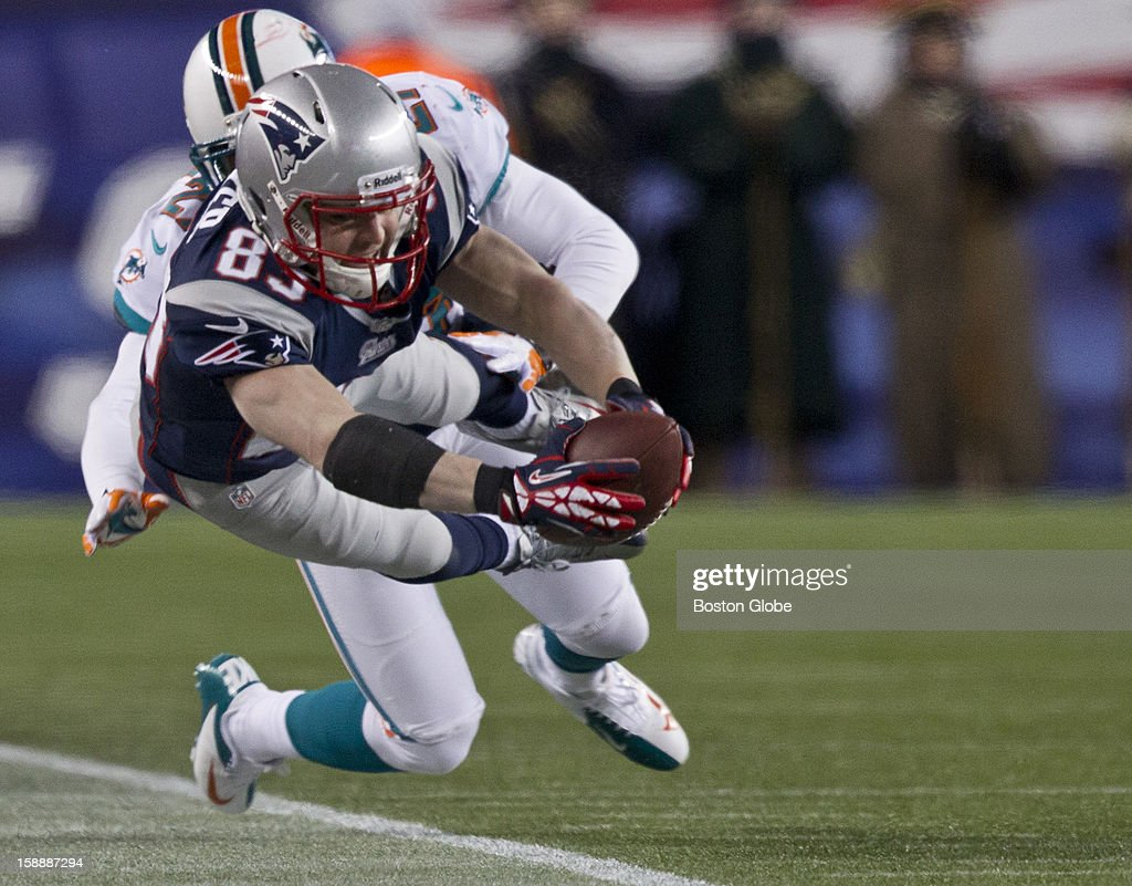New England Patriots player Wes Welker dives for the first down marker but comes up short as the Miami Dolphins' Reshad Jones pushes him out of bounds during third quarter action at Gillette Stadium on Sunday, Dec. 30, 2012.