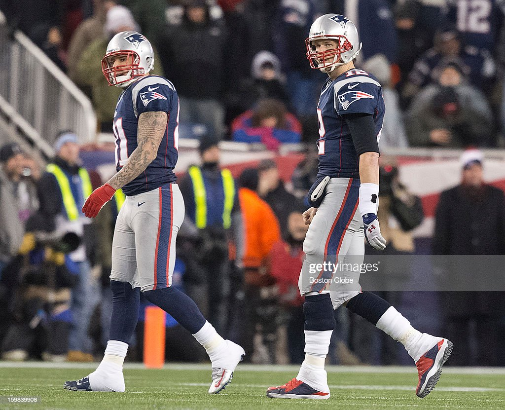 New England Patriots players Aaron Hernandez, left, and Tom Brady walk off the field after Brady threw an interception against the Baltimore Ravens during fourth quarter action of the AFC Championship Game at Gillette Stadium on Sunday, Jan. 20, 2013.