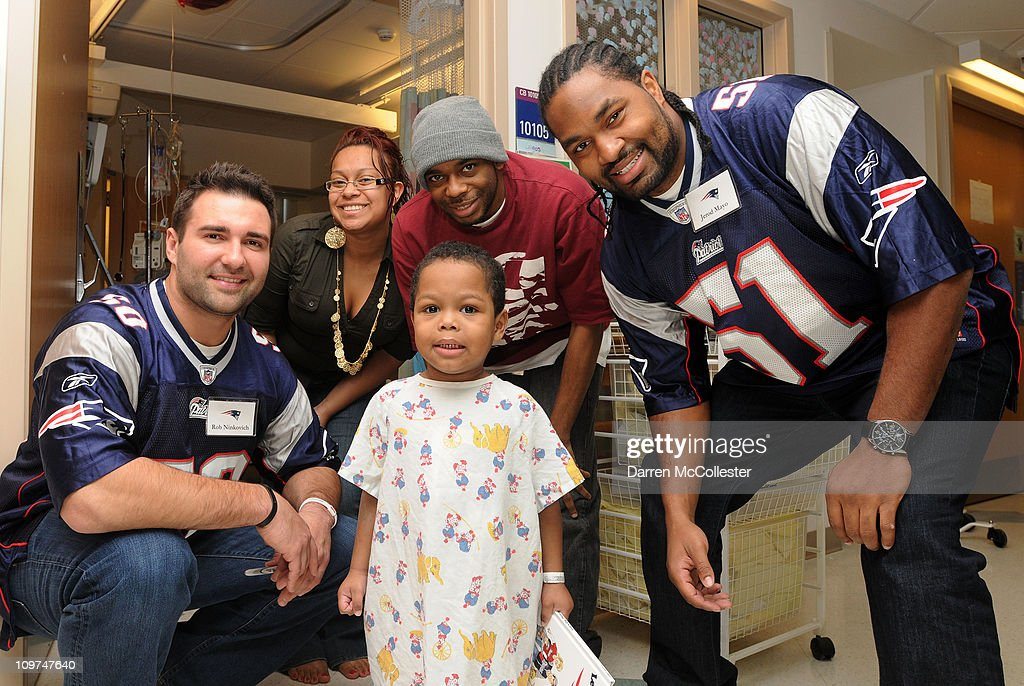 New England Patriots players (L to R) Rob Ninkovich and Jerod Mayo spread cheer to patient Ashon March 3, 2011 at Children's Hospital Boston in Boston, Massachusetts. The players also participated in the Mix 104.1 Cares For Kids Radiothon.