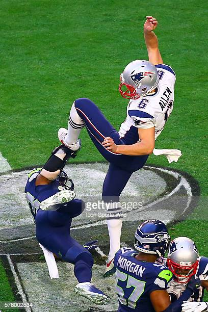 New England Patriots punter Ryan Allen gets hit by Seattle Seahawks strong safety Jeron Johnson during the first quarter of Super Bowl XLIX being...