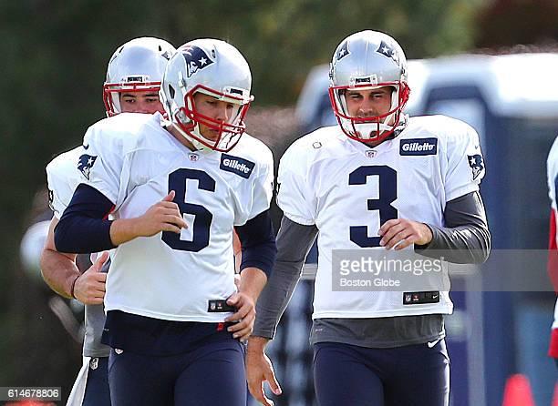 New England Patriots punter Ryan Allen left and kicker Stephen Gostkowski chat during warmups before practice at Gillette Stadium in Foxborough Mass...
