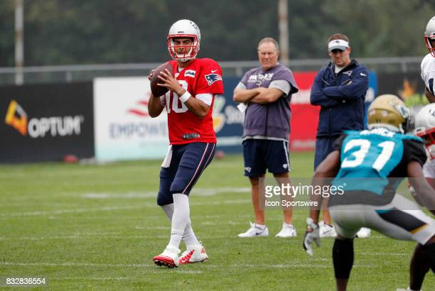 New England Patriots quarterback Jimmy Garoppolo eyes his receiver during a joint New England Patriots and Jacksonville Jaguars training camp on...