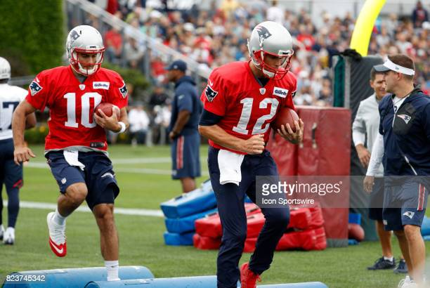 New England Patriots quarterback Jimmy Garoppolo follows New England Patriots quarterback Tom Brady over the obstacles during New England Patriots...