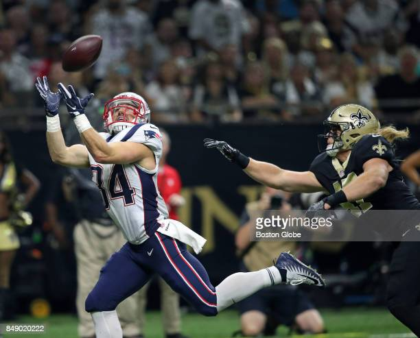 New England Patriots quarterback Rex Burkhead leaves New Orleans Saints linebacker Alex Anzalone in the dust as he hauls in a first quarter touchdown...