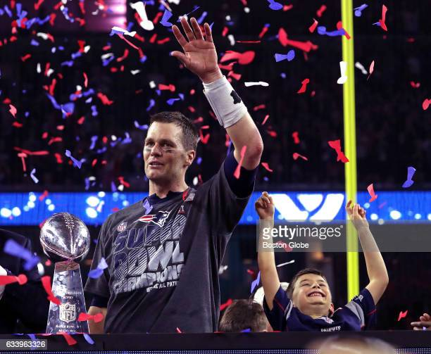 New England Patriots quarterback Tom Brady and his son celebrate after the Patriots defeated the Atlanta Falcons in Super Bowl LI at NRG Stadium in...
