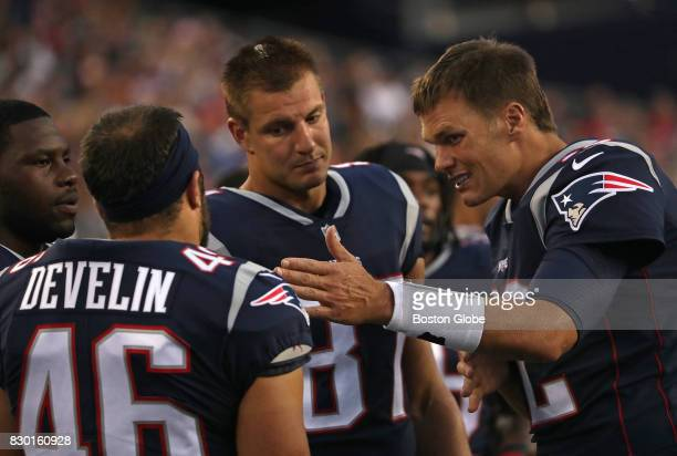 New England Patriots quarterback Tom Brady and New England Patriots tight end Rob Gronkowski are pictured on the sidelines but did not play against...