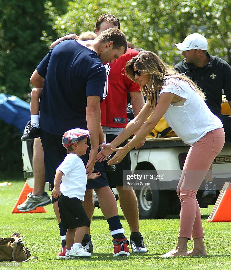 New England Patriots quarterback <a gi-track='captionPersonalityLinkClicked' href=/galleries/search?phrase=Tom+Brady+-+Football-Spieler+-+Quarterback&family=editorial&specificpeople=201737 ng-click='$event.stopPropagation()'>Tom Brady</a> carries his son John, as he chatted with Saints quarterback <a gi-track='captionPersonalityLinkClicked' href=/galleries/search?phrase=Drew+Brees&family=editorial&specificpeople=202562 ng-click='$event.stopPropagation()'>Drew Brees</a> at the end of practice, as Brady's wife, Gisele Bundchen, right, gets their other son, Benjamin. The New England Patriots held practice with the New Orleans Saints at the practice fields during training camp.