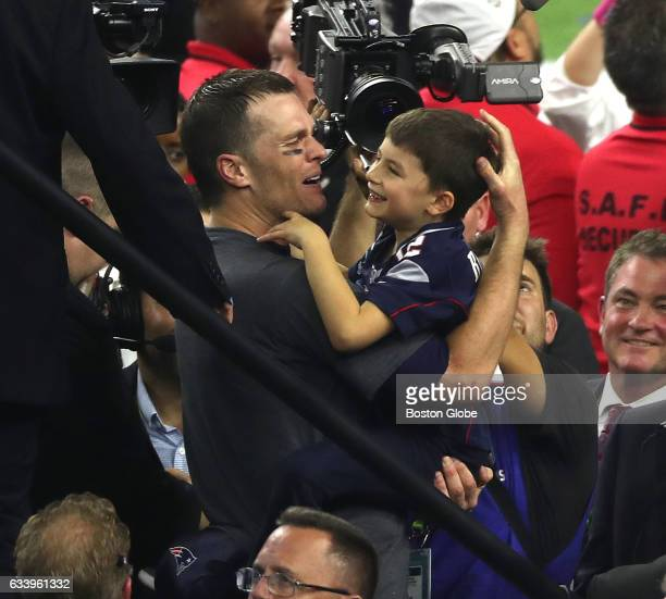 New England Patriots quarterback Tom Brady celebrates winning Super Bowl LI with his son The Patriots defeated the Atlanta Falcons in overtime at NGR...