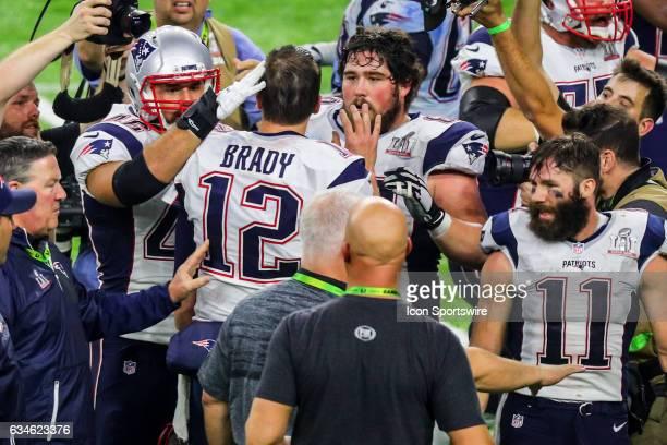 New England Patriots quarterback Tom Brady celebrates with teammate New England Patriots center David Andrews after winning Super Bowl LI on February...
