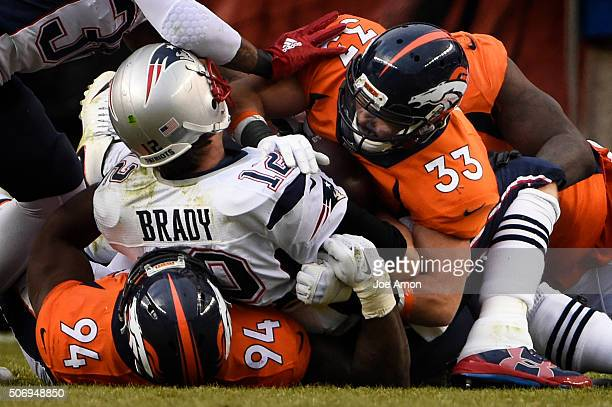 New England Patriots quarterback Tom Brady crushed by the Denver Broncos defense in the AFC championship game at Sports Authority Field at Mile High...