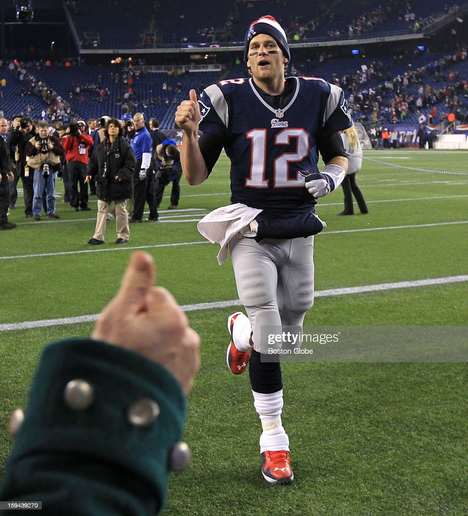 New England Patriots quarterback Tom Brady (#12) gives a thumbs up as he leaves the field following the win over the Houston Texans. The New England Patriots hosted the Houston Texans in an NFL AFC Divisional Playoff Game at Gillette Stadium, Jan. 13, 2013.