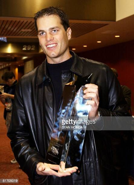 New England Patriots quarterback Tom Brady holds the Most Valuable Player award for Super Bowl XXVI 04 February in New Orleans LA At 24 Brady is the...