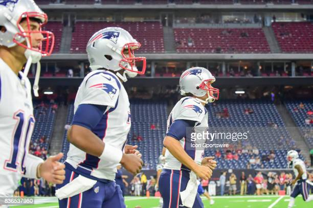 New England Patriots quarterback Tom Brady leads New England Patriots quarterback Jacoby Brissett and New England Patriots quarterback Jimmy...