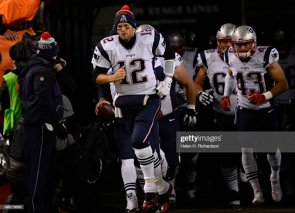 New England Patriots quarterback <a gi-track='captionPersonalityLinkClicked' href=/galleries/search?phrase=Tom+Brady+-+American+Football+Quarterback&family=editorial&specificpeople=201737 ng-click='$event.stopPropagation()'>Tom Brady</a> (12) leads the team out to the field against the Denver Broncos November 29, 2015 at Sports Authority Field at Mile High Stadium.