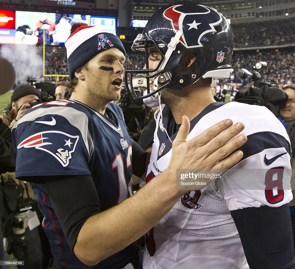 New England Patriots quarterback Tom Brady offers words of advice to Houston Texans quarterback Matt Schaub after the Patriots defeated the Texans 41-28 in an NFL AFC Divisional Playoff Game at Gillette Stadium, Jan. 13, 2013.