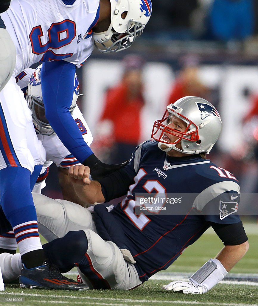 New England Patriots quarterback <a gi-track='captionPersonalityLinkClicked' href=/galleries/search?phrase=Tom+Brady+-+American+Football+Quarterback&family=editorial&specificpeople=201737 ng-click='$event.stopPropagation()'>Tom Brady</a> reacts after being knocked down in third quarter action. The New England Patriots hosted the Buffalo Bills in a regular season Monday Night Football game at Gillette Stadium, Nov. 23, 2015.