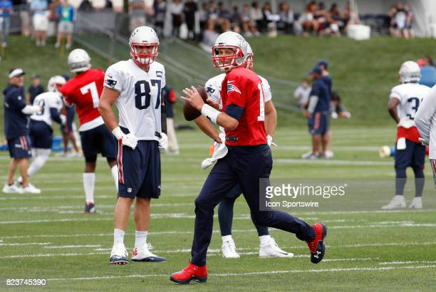 New England Patriots quarterback Tom Brady rolls out of the pocket during New England Patriots training camp on July 27 at the Patriots Practice...