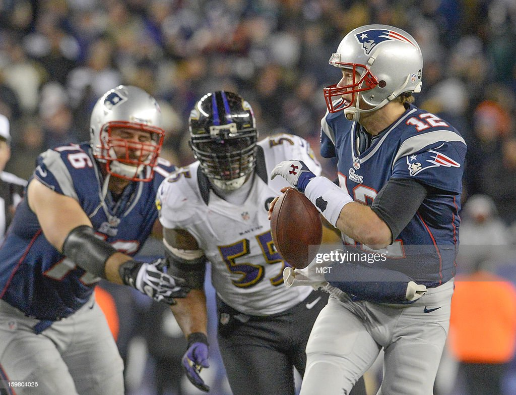 New England Patriots quarterback Tom Brady runs from the pocket to escape the oncoming pressure of Baltimore Ravens outside linebacker Terrell Suggs during the second half of the AFC Championship game at Gillette Stadium in Foxboro, Massachusetts, Sunday night, January 20, 2013.