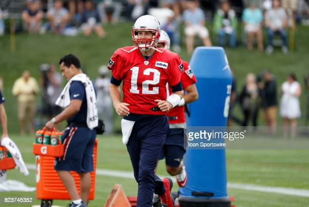 New England Patriots quarterback Tom Brady runs out for his first drill of camp during New England Patriots training camp on July 27 at the Patriots...