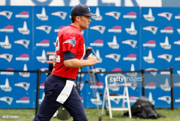New England Patriots quarterback Tom Brady runs out onto the field during New England Patriots training camp on July 27 at the Patriots Practice...