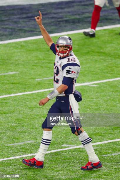 New England Patriots quarterback Tom Brady signals to go for a two point conversion during the second half of Super Bowl LI on February 5 at NRG...