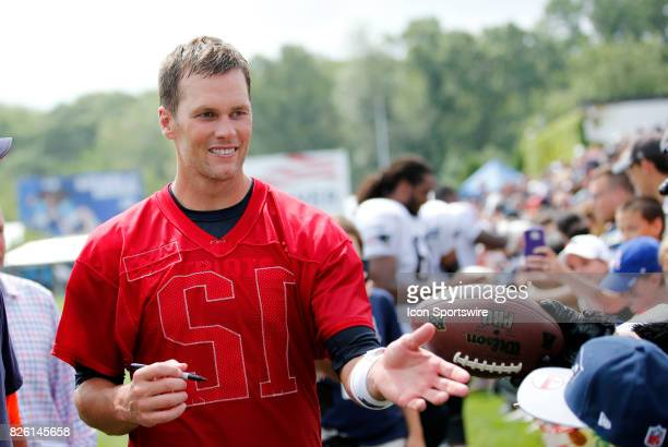 New England Patriots quarterback Tom Brady signs autographs on his 40th birthday during Patriots training camp on August 3 at Gillette Stadium in...